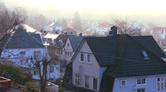 A residential street ion Bergen, Norway in foggy morning light. - stock footage