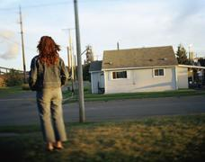Woman Standing in Subdivision, Sault Sainte Marie, Ontario, Canada - stock photo