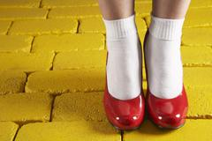 Red Shoes on Yellow Bricks Stock Photos