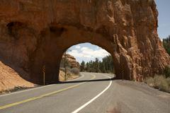 Road Through Rock Face, Dixie National Forest, Utah, USA - stock photo