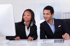 two business people in office - stock photo