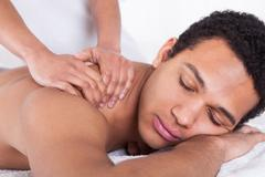 man receiving massage from female hand - stock photo