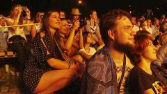 Spectators watch performance artists. - stock footage