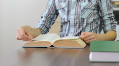 Student reading an interesting book at the university study room, attention Stock Footage