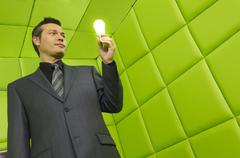 Man with Lightbulb in Green Padded Room Stock Photos