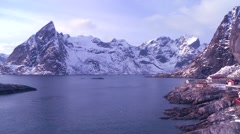 Pan to an amazing view of a red fishing village in the Arctic Lofoten Islands, - stock footage