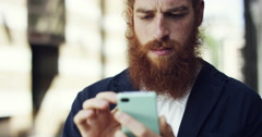 Hipster man using smartphone touchscreen connected sharing economy Stock Footage