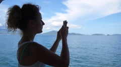 Girl Taking Picture of Seascape. Slow Motion. Stock Footage