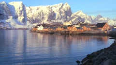 Fishing huts stand in rows in a village in the Arctic Lofoten Islands, Norway. - stock footage