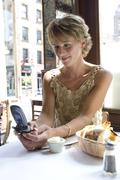 Woman Using Cellular Phone in Cafe Stock Photos