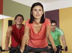 People Using Exercise Bicycles Stock Photos