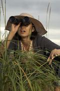 Woman Using Binoculars - stock photo
