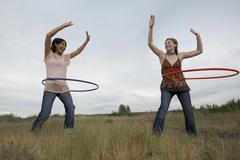 Friends Playing with Hula-Hoops - stock photo
