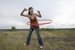 Woman Playing with Hula-Hoop - stock photo