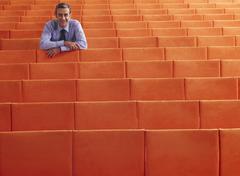 Businessman Sitting in Auditorium - stock photo
