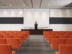 Businesswoman in Auditorium - stock photo