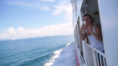 Woman Sailing on Ferry and Taking Photo, Slow Motion. Stock Footage