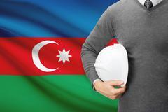 architect with flag on background  - azerbaijan - stock photo