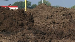 Tracked shovel shifts layer of clay - close up Stock Footage