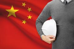 architect with flag on background  - people's republic of china - stock photo