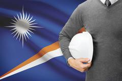 architect with flag on background  - marshall islands - stock photo