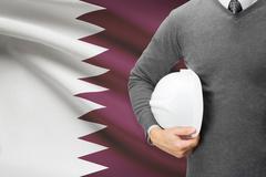 architect with flag on background  - qatar - stock photo