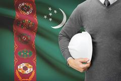 architect with flag on background  - turkmenistan - stock photo