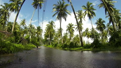 Water on the road during rainy season in tropical countryside. - stock footage