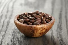 freshly roasted arabica coffee beans in bowl - stock photo