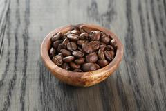 Freshly roasted arabica coffee beans in bowl Stock Photos