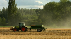 Tractor fertilizing large field Stock Footage