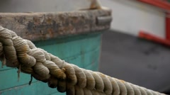 Texture of mooring rope of fishing boat in harbour Stock Footage