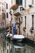 Boats Anchored on Canal, Venice, Italy Stock Photos