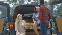Young people in car drinking coffee Stock Footage