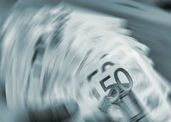 Euro currency in a spin Stock Photos