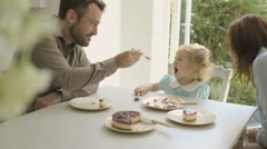 Family eating cake - stock footage