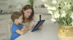 Mother and son with digital tablet Stock Footage