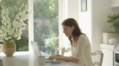 Woman using laptop - stock footage