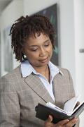Businesswoman Reading Appointment Book Stock Photos