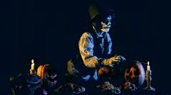Jack O'lantern Ligntening Candles Inside Pumpkins Stock Footage