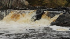 Fast moving waterfall rushing over large rocks Stock Footage