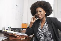 Businesswoman Using Cell Phone Stock Photos