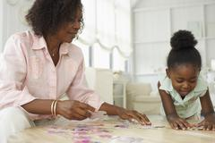 Mother and daughter playing games Stock Photos
