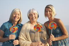 Portrait of Women with Lollipops Stock Photos