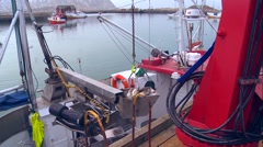 Fish is brought out of the hold of a fishing boat along a dock in Norway. Arkistovideo