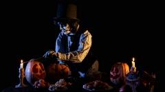 Jack O'lantern Ligntens Candles Inside Pumpkins Stock Footage