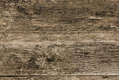 Grungy wooden surface as abstract background.sepia. Stock Photos