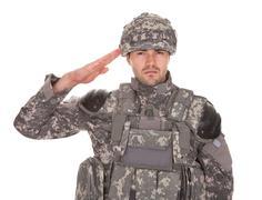 portrait of man in military uniform saluting - stock photo