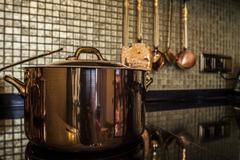 copper saucepan on the stove - stock photo
