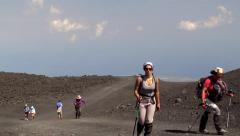 Tourists on the long hiking to the crater area of Mount Etna. Sicily Stock Footage